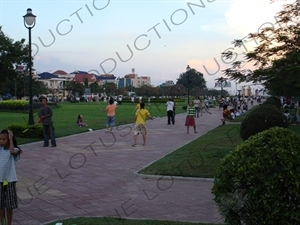 People Playing Badminton in a Park near the Royal Palace in Phnom Penh