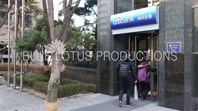 People Walking in to Citibank in Seoul