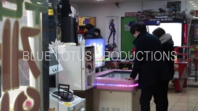 People Playing Games in an Arcade in Seoul