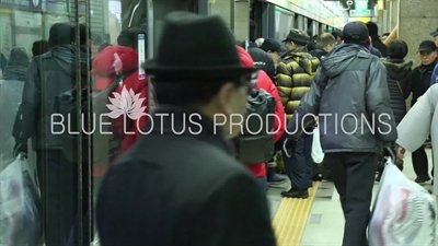 People Getting on and off a Train in a Seoul Metro station