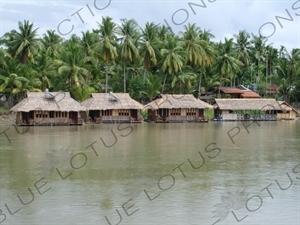 Houses on a Bank of the Mekong River