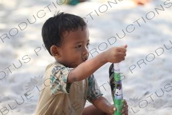 Small Boy Playing on a Beach on Gili Meno